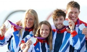 Great Britain's silver medallists in the women's and men's sailing 470 two-person dinghy (from L) Saskia Clark, Hannah Mills, Luke Patience and Stuart Bithell smile on the podium at the London 2012 Olympic Games in Weymouth on August 10, 2012. AFP PHOTO / William WESTWILLIAM WEST/AFP/GettyImages